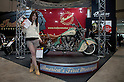Mar 25, 2012 - Tokyo, Japan - This event assistant shows a pamphlet of Indian Motorcycle at the 39th Tokyo Motorcycle Show, Tokyo Big Sight on March 25, 2012. This is the largest motorcycle exhibition in Japan, from March 23 to 25 this year.