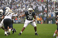 State College, PA - 9/2/2006 - Penn State offensive linemen Gerald Cadogan (76) looks to block the rushing defensive linemen in the game against the University of Akron on September 2, 2006, at Beaver Stadium.  The Nittany Lions defeated the Zips 34-16 on a soggy day...Photo credit:  Joe Rokita / JoeRokita.com