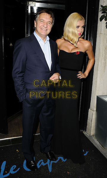 LONDON, ENGLAND - OCTOBER 28: Raymond Blanc &amp; Katherine Jenkins attends the Martell Very Special Nights launch party, Le Caprice bar &amp; restaurant on October 28, 2013 in London, England, UK.<br /> full length black print top jeans denim ankle boots<br /> CAP/CAN<br /> &copy;Can Nguyen/Capital Pictures