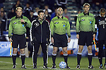 12 December 2014: Match officials (from left): Assistant referee Jeff Mushik, fourth official Edvin Juresivic, referee Ted Unkel, and assistant referee Andrew Bigelow. The University of California Los Angeles Bruins played the Providence College Friars at WakeMed Stadium in Cary, North Carolina in a 2014 NCAA Division I Men's College Cup semifinal match. UCLA won the game 3-2 in overtime.