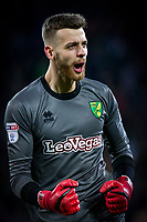 Angus Gunn of Norwich City (on loan from Manchester City) celebrates his side's first goal during the Sky Bet Championship match between Cardiff City and Norwich City at the Cardiff City Stadium, Cardiff, Wales on 1 December 2017. Photo by Mark  Hawkins / PRiME Media Images.