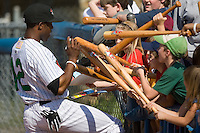 John Shelby III (12) of the Winston-Salem Warthogs autographs souvenir bats prior to the start of the game at Ernie Shore Field in Winston-Salem, NC, Saturday, May 17, 2008.