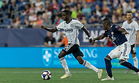 FOXBOROUGH, MA - JUNE 27: Jamiro Monteiro #35 dribbles as Luis Caicedo #27 closes during a game between Philadelphia Union and New England Revolution at Gillette Stadium on June 27, 2019 in Foxborough, Massachusetts.