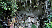 cemetery outside a cave with effigee puppets representing the deceased ancestor in Toraja land, Sulawesi, Indonesia.