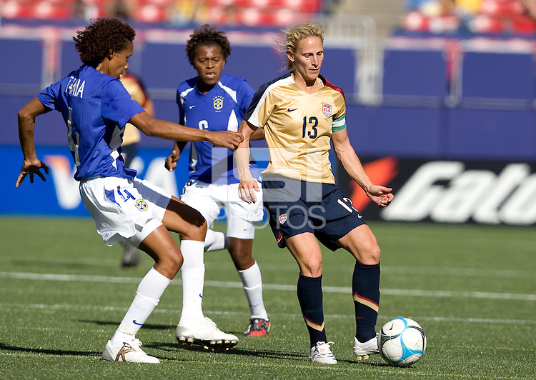 Kristine Lilly slides a pass away from Brazil's Tania. USA defeated Brazil 2-0 at Giants Stadium on Sunday, June 23, 2007.