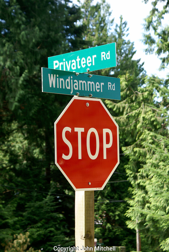 Road sign and stop sign on Bowen Island, British Columbia, Canada