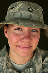 PFC Megan Hartjen, 21, Simi Valley, CA, Medic, Charlie Medical Company 501st Field Support Battalion 1st Brigade 1st Armored Division taken at the company's medical facility at Camp Ramadi, Iraq on Saturday Sept. 30, 2006.