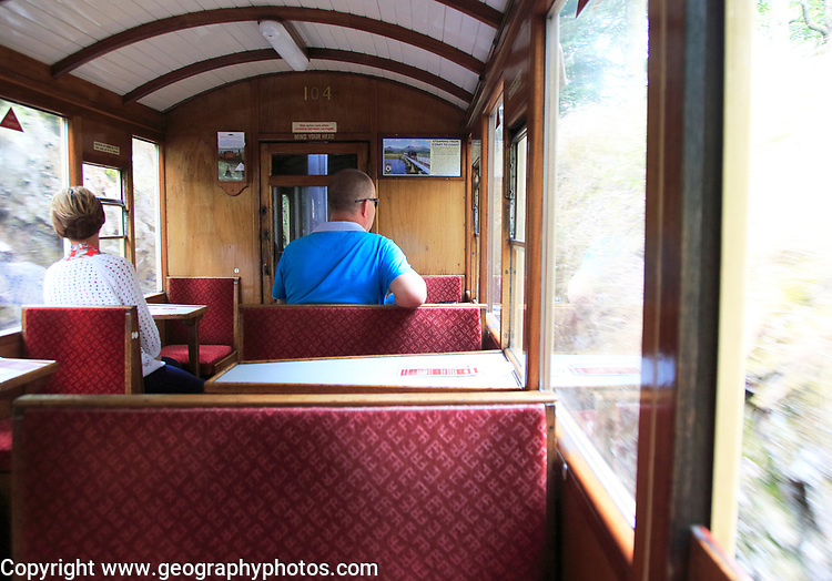 Passengers inside train carriage of Ffestiniog railway, Gwynedd, north west Wales, UK
