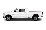 Car driver side profile view of a 2015 Ram 2500 Laramie 4 Door Van
