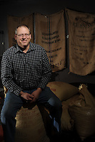 NWA Democrat-Gazette/ANDY SHUPE - Rick Boosey is the president and founder of KYYA Chocolate, a chocolate company in Elm Springs, and has traveled around the world for his business.