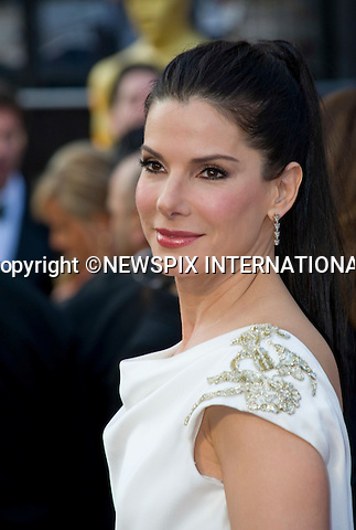 "OSCARS 2012 - SANDRA BULLOCK.84th Academy Awards arrivals, Kodak Theatre, Hollywood, Los Angeles_26/02/2012.Mandatory Photo Credit: ©Dias/Newspix International..**ALL FEES PAYABLE TO: ""NEWSPIX INTERNATIONAL""**..PHOTO CREDIT MANDATORY!!: NEWSPIX INTERNATIONAL(Failure to credit will incur a surcharge of 100% of reproduction fees)..IMMEDIATE CONFIRMATION OF USAGE REQUIRED:.Newspix International, 31 Chinnery Hill, Bishop's Stortford, ENGLAND CM23 3PS.Tel:+441279 324672  ; Fax: +441279656877.Mobile:  0777568 1153.e-mail: info@newspixinternational.co.uk"