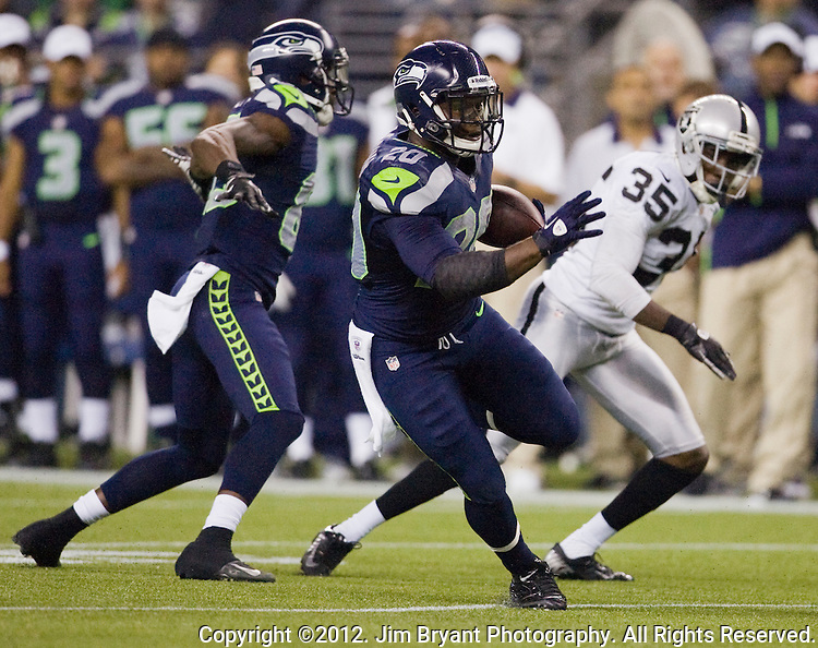 Seattle Seahawks' running back Kregg Lumpkin rushes against the Oakland Raiders in a pre-season game at CenturyLink Field in Seattle on August, 30, 2012.   ©2012. Jim Bryant Photo. All Rights Reserved.