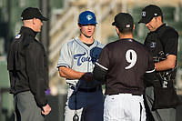 Asheville Tourists manager Warren Schaeffer (13) meets with Kannapolis Intimidators manager Justin Jirschele (9) and umpires Mike Snover (left) and Emil Jimenez prior to the game at Kannapolis Intimidators Stadium on May 8, 2017 in Kannapolis, North Carolina.  The Tourists defeated the Intimidators 7-5.  (Brian Westerholt/Four Seam Images)