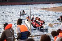 Sea Watch-2.<br /> Die Sea Watch-2 bei ihrer 13. SAR-Mission vor der libyschen Kueste.<br /> Im Bild: Gefluechtete werden von der Sea Watch-2 zu einem Schiff gebracht, welches sie nach Europa bringen soll.<br /> 21.10.2016, Mediterranean Sea<br /> Copyright: Christian-Ditsch.de<br /> [Inhaltsveraendernde Manipulation des Fotos nur nach ausdruecklicher Genehmigung des Fotografen. Vereinbarungen ueber Abtretung von Persoenlichkeitsrechten/Model Release der abgebildeten Person/Personen liegen nicht vor. NO MODEL RELEASE! Nur fuer Redaktionelle Zwecke. Don't publish without copyright Christian-Ditsch.de, Veroeffentlichung nur mit Fotografennennung, sowie gegen Honorar, MwSt. und Beleg. Konto: I N G - D i B a, IBAN DE58500105175400192269, BIC INGDDEFFXXX, Kontakt: post@christian-ditsch.de<br /> Bei der Bearbeitung der Dateiinformationen darf die Urheberkennzeichnung in den EXIF- und  IPTC-Daten nicht entfernt werden, diese sind in digitalen Medien nach §95c UrhG rechtlich geschuetzt. Der Urhebervermerk wird gemaess §13 UrhG verlangt.]
