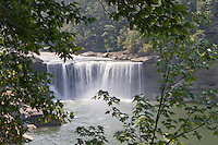 Cumberland Falls through trees, Cumberland Falls State Park in Kentucky.