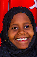 Nubian girl wearing head scarf, Nubian village near Aswan, Egypt