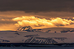 Sunrise, Svalbard, Norway<br /> This arctic archipelago is a landscape created by ice age glaciation.  Deep fjords, valleys and high peaks were carved from a high plateau into what we witness today.