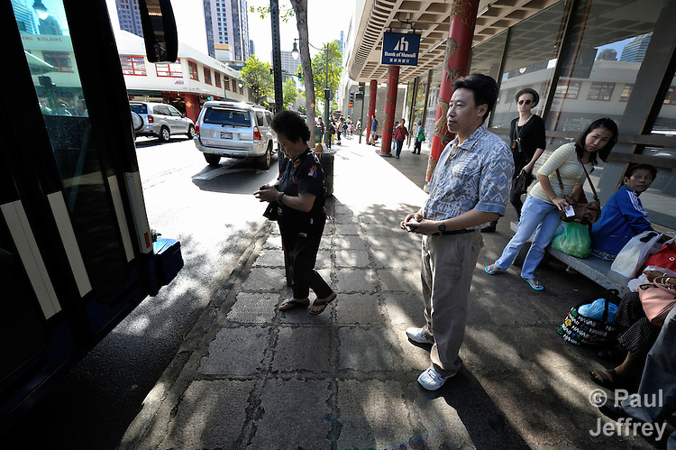Hieu Van Bui, a Vietnamese survivor of human trafficking, waits to board a bus in the Chinatown neighborhood of Honolulu, Hawaii. He has received assistance from the Susannah Wesley Community Center, which has played a key role in identifying and supporting victims of trafficking in Hawaii.