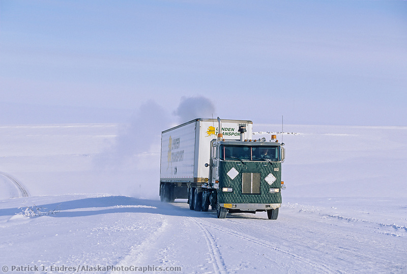 Semi truck hauls supplies to Prudhoe Bay Oil fields on the snow covered James Dalton Highway, arctic north slope, Alaska
