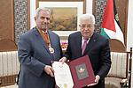 Palestinian President Mahmoud Abbas, honors Ambassador Nabil Maarouf, in the West Bank city of Ramallah, on January 26, 2020. Photo by Thaer Ganaim