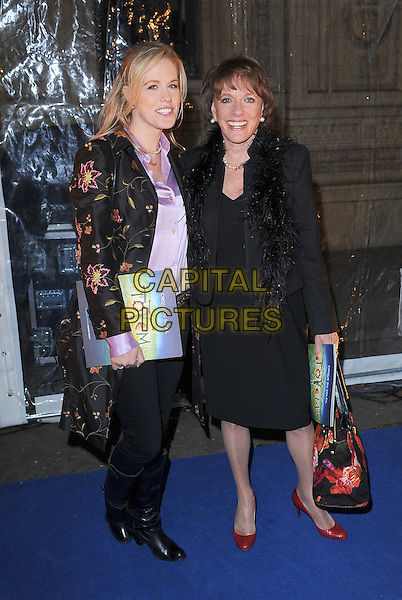 Rebecca Wilcox and Esther Rantzen.'Cirque Du Soleil: Totem' UK Premiere, Royal Albert Hall, London, England..5th January 2012.full length black jeans denim boots dress fur boa jacket mother mom mum daughter family print .CAP/BEL.©Tom Belcher/Capital Pictures..