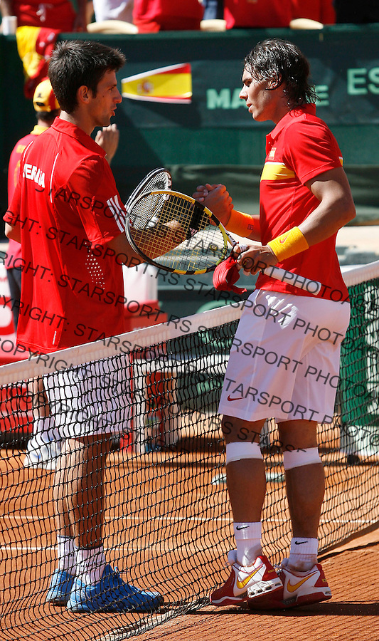 Tenis, DAVIS CUP, World group, first round.SPAIN Vs. SERBIA.Rafael Nadal Vs. Novak Djokovic.Rafael Nadal, right and Novak Djokovic.Benidorm, 03.08.2009..Photo: © Srdjan Stevanovic/Starsportphoto.com