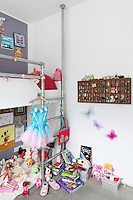 9 year old Flora shares her bunk bed with an army of animals and dolls