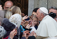 Pope Francis kisses a child at the end of his visit to the Basilica of Santa Sofia and to the Ukrainian greek-catholic community, in Rome January 28, 2018.<br /> <br /> UPDATE IMAGES PRESS/Riccardo De Luca<br /> <br /> STRICTLY ONLY FOR EDITORIAL USE