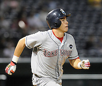 Sept. 17, 2009: Catcher Travis D'Arnaud (5) of the Lakewood BlueClaws runs out a fly ball in Game 3 of the South Atlantic League Championship Series between the Greenville Drive and the BlueClaws at Fluor Field at the West End in Greenville, S.C. Photo by: Tom Priddy/Four Seam Images