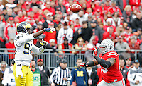 Michigan Wolverines quarterback Devin Gardner (98) throws over Ohio State Buckeyes defensive tackle Michael Bennett (63) in the 1st quarter of their game at Ohio Stadium in Columbus, Ohio on November 29, 2014.  (Dispatch photo by Kyle Robertson)