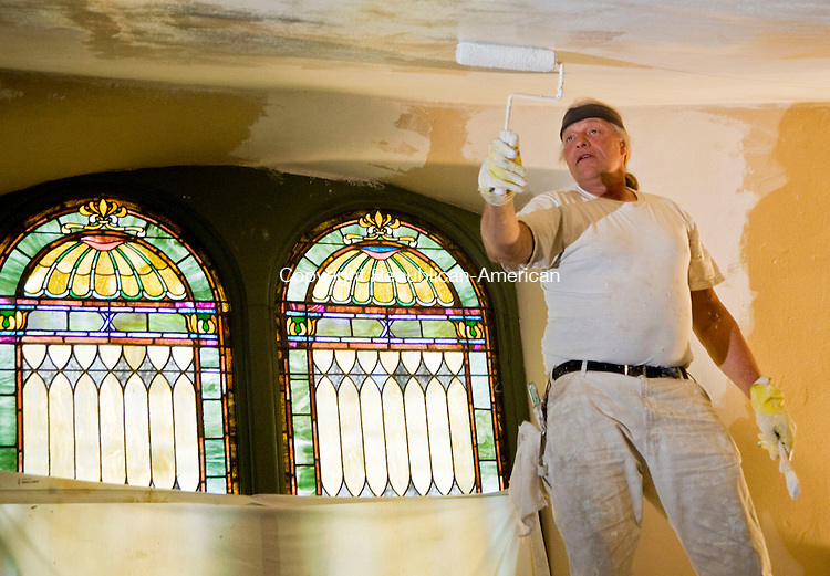 WINSTED, CT - 14 APRIL 2010 -041410JT02-<br /> Maxwell Smith of Harwinton paints the underbelly of the balcony at the Church of Christ in Winsted as interior renovations are being undertaken on the more than 100-year-old building on Wed., April 14.<br /> Josalee Thrift Republican-American