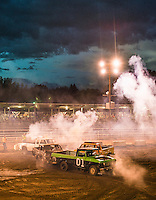 Demolition Derby at the Routt County Fair in Hayden, Colorado, Friday, August 14, 2015.<br /> <br /> Photo by Matt Nager