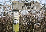 Close up wooden public footpath sign, no through route due to coastal erosion, River Deben, Waldringfield, Suffolk, England, UK