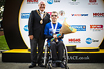 © Joel Goodman - 07973 332324. 15/10/2017 . Manchester , UK . Winner of the wheelchair race ADAM GOLDSPINK-BURGESS accepts his trophy at the end of the Greater Manchester Half Marathon in Old Trafford . Photo credit : Joel Goodman