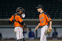 AZL Giants relief pitcher John Russell (53) and catcher Andres Angulo (1) celebrate after a win against the AZL Cubs on September 6, 2017 at Sloan Park in Mesa, Arizona. AZL Giants defeated the AZL Cubs 6-5 to even up the Arizona League Championship Series at one game a piece. (Zachary Lucy/Four Seam Images)