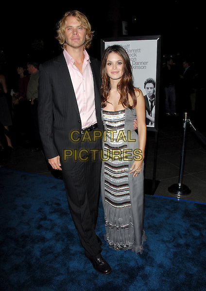 "ERIC CHRISTIAN OLSEN & RACHEL BILSON.L.A. Premiere of ""The Last Kiss"" held at The DGA in West Hollywood, California, USA..September 13th, 2006.Ref: DVS.full length grey gray silver dress stripes striped black suit.www.capitalpictures.com.sales@capitalpictures.com.©Debbie VanStory/Capital Pictures"