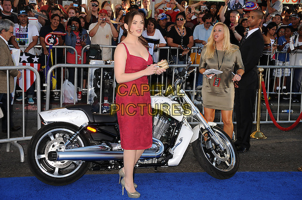 "Hayley Atwell.Premiere of ""Captain America: The First Avenger"" held at The El Capitan Theatre in Hollywood, California, USA..July 19th, 2011.full length pink dress  grey gray shoes clutch bag motorcycle motorbike bike.CAP/ROT/TM.©Tony Michaels/Roth Stock/Capital Pictures"
