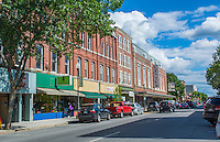 Waterville Maine downtown traffic on Main Street with cars and shops