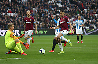West Ham United's Javier Hernandez is foiled by Huddersfield Town's Jonas Lossl<br /> <br /> Photographer Rob Newell/CameraSport<br /> <br /> The Premier League - West Ham United v Huddersfield Town - Saturday 16th March 2019 - London Stadium - London<br /> <br /> World Copyright © 2019 CameraSport. All rights reserved. 43 Linden Ave. Countesthorpe. Leicester. England. LE8 5PG - Tel: +44 (0) 116 277 4147 - admin@camerasport.com - www.camerasport.com