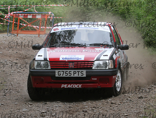 Scott Peacock - Craig Service in a Peugeot 205 Gti at Junction 3 on the Heathhall Special Stage of the RSAC Scottish Rally 2014, Round 3 of the MSA British Rally Championship, Round 4 of the RAC MSA Scottish Rally Championship sponsored by ARR Craib Transport Limited and other championships which was organised by the Royal Scottish Automobile Club and based at Dumfries on 27-28.6.14.