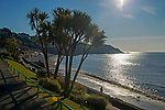 Swansea, UK, 26th March 2020.<br />A man walks his dog on the beach at Langland Bay near Swansea this morning on the start of a sunny spring day.