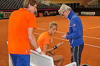 Februari 04, 2015, Apeldoorn, Omnisport, Fed Cup, Netherlands-Slovakia, Training Dutch team, Arantxa Rus with coach Martin Bohm, left captain Paul Haarhuis<br /> Photo: Tennisimages/Henk Koster