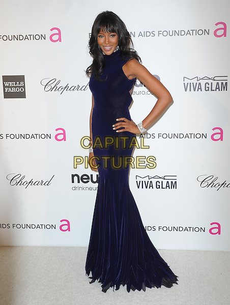 Naomi Campbell.The 21st Annual Elton John AIDS Foundation Academy Awards Viewing Party held at The City of West Hollywood Park in West Hollywood, California, USA..February 24th, 2013.oscars full length black midnight navy blue dress sleeveless hand on hip diamond bracelets .CAP/DVS.©DVS/Capital Pictures.