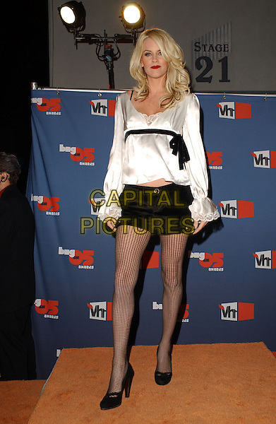 JENNY McCARTHY.The VH1 Big In '05 Award Show held at The Sony Picture Studios in Culver City, California .December 3rd, 2005.Ref: DVS.full length black fishnet stockings tights white silk satin top shorts.www.capitalpictures.com.sales@capitalpictures.com.Supplied By Capital PIctures