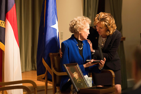 "April 16, 2014. Durham, North Carolina.<br />  Senator Kay Hagan, right, hands Wanda Moore a medal to honor her late husband Donald Moore for his service in World War II.<br />  Kay Hagan (D),  US Senator from North Carolina, attended an event to honor the military service of Donald ""Buddy"" Moore, Hagan awarded Moore's widow Wanda a posthumous Bronze Star, as well as several other medals, for his service in World War II."