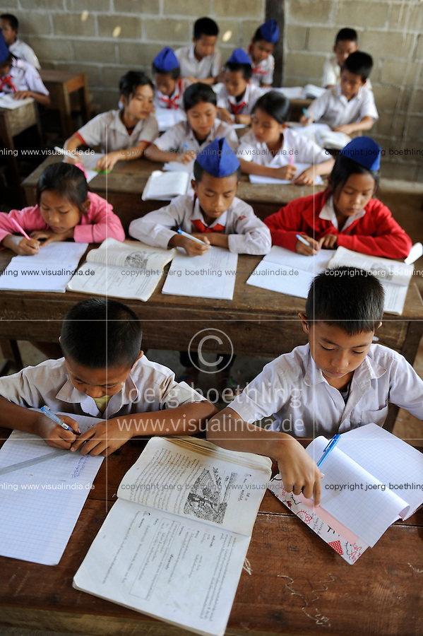 LAOS Province Vientiane village Tham , children in school, school uniform of the communist Pioneer movement / Kinder in einer Dorfschule in Kleidung der kommunistischen Pionierorganisation