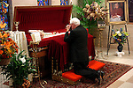 Bishop Robert Banks prays near Bishop Aloysius J. Wycislo during the visitation at St. Francis Xavier Cathedral in Green Bay on October 13, 2005.  Wycislo died Tuesday at the age of 97.
