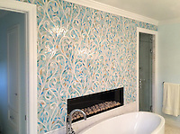 This custom bathroom features Climbing Vine, a handmade New Ravenna mosaic shown in Aquamarine and Quartz jewel glass.<br />