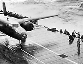 Taken from the deck of the U.S.S. Hornet (CU-8) of a B-25 bomber on its way to take part in the first United States air raid on Japan.  The bombing mission on April 18, 1942 (4 months after Pearl Harbor) had a total of 16 B-25 bombers taking off from the carrier Hornet to fly 620 miles and conduct bombing raids over several principle Japanese cities. It was commanded by Colonel Jimmy Doolittle and its success helped raise the morale of United States troops..Credit: U.S. Air Force via CNP