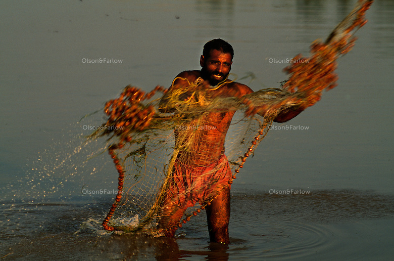 A fisherman throws a net out in the Indus River.<br /> The Indus provides the key water resources for the economy of Pakistan - especially the Breadbasket of Punjab province.